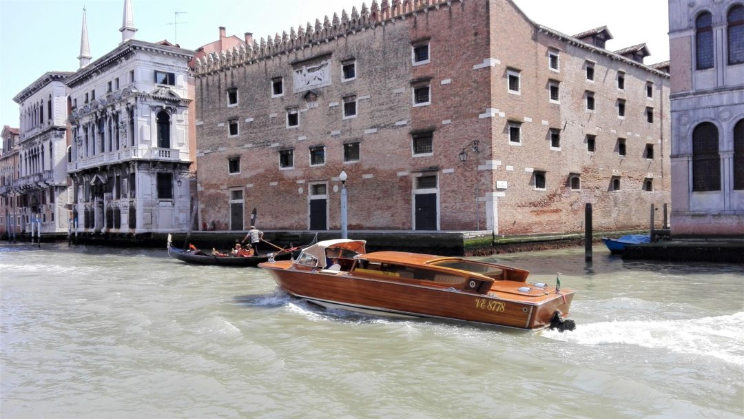 Boat and gondola on Venice canal