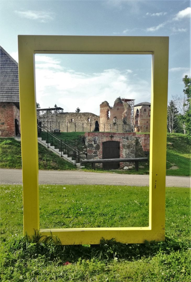Ruins of the Vastseliina Episcopal Castle in South Estonia - Yellow national geographic window frame