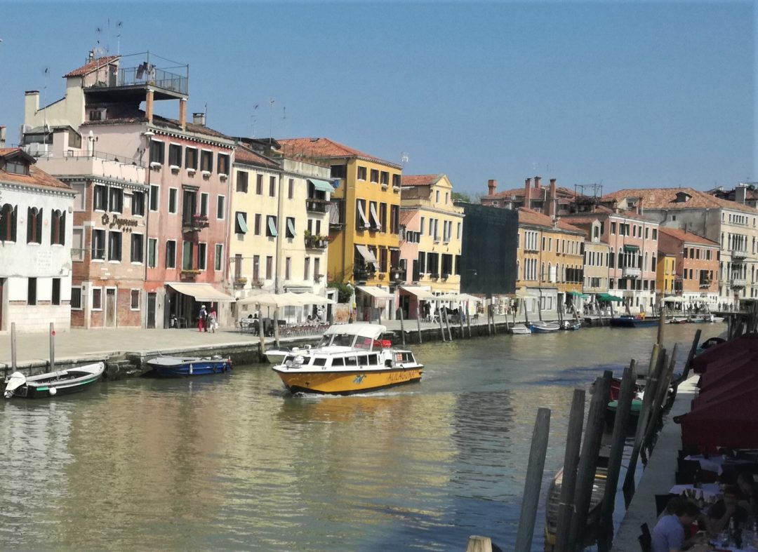Boat riding on canal in Venice