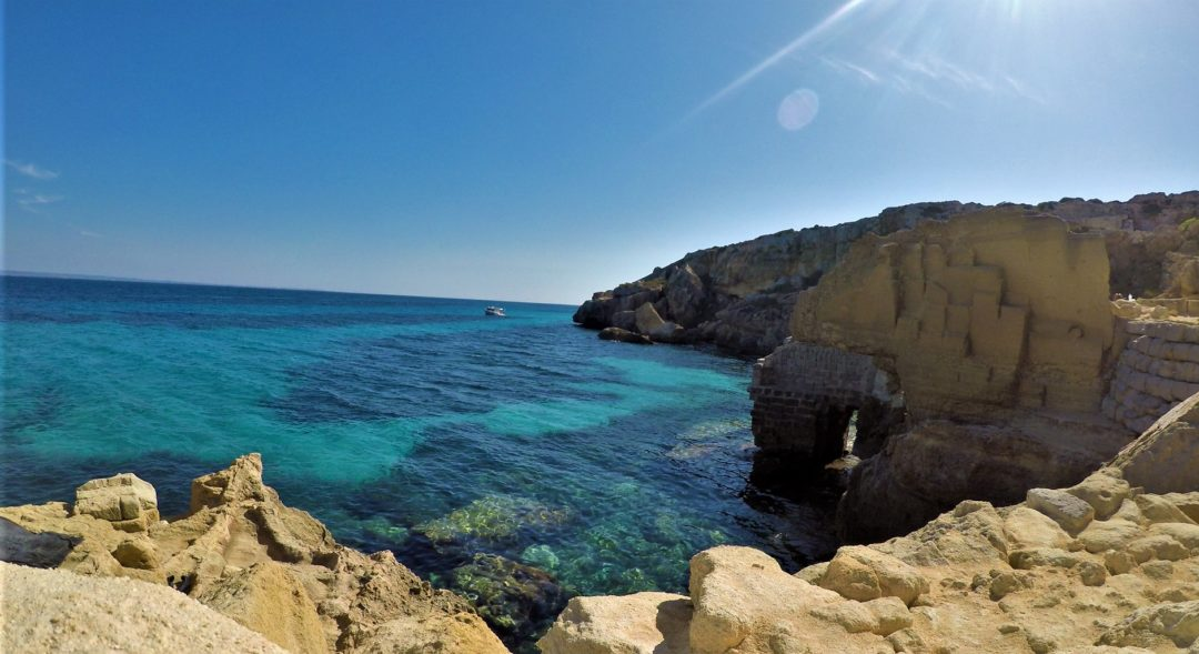 Favignana island, Cala Bue Marino - crystal clear water with blue stripes visible